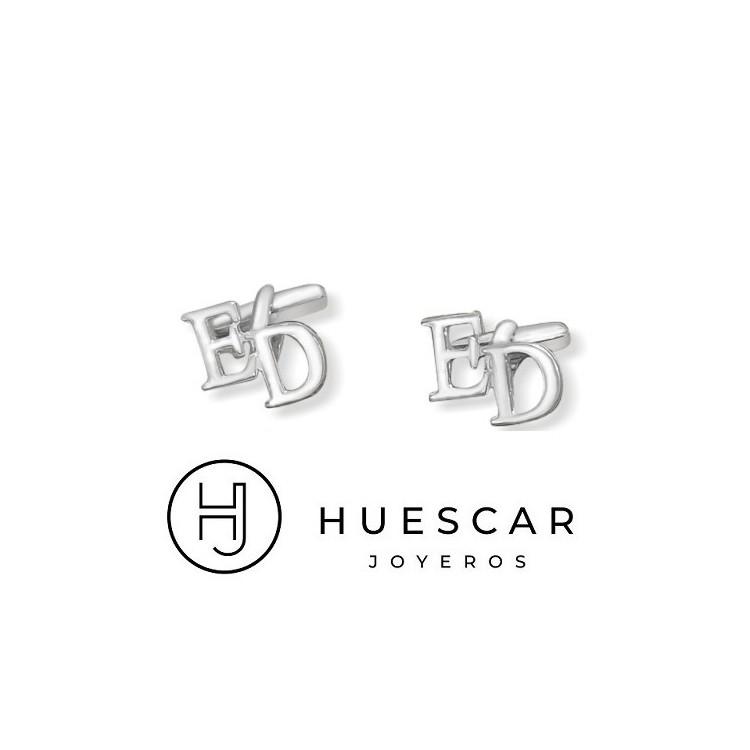 Gemelos iniciales de plata